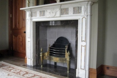 Antique Georgian statuary and sienna marble fireplace