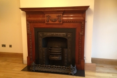 19th century mahogany fireplace with cast iron hob insert