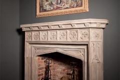 Gothic stone fireplace by Ryan & Smith