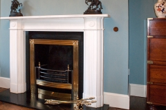 The Penrose marble fireplace installed with a Kildare brass grate.