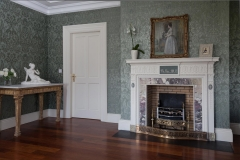 Antique neo-classical painted pine fireplace with marble slips