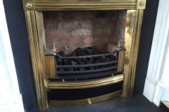 Brass register grate with reclaimed brick chamber