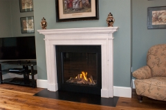The Claremount fireplace made in Portland stone and fitted with a gas stove
