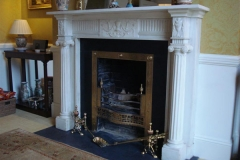 Bespoke marble fireplace made by Ryan & Smith
