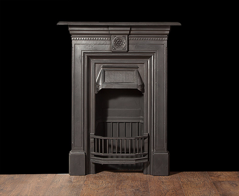 A Small Antique Cast Iron Bedroom Fireplace